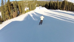 A skier does a backflip jump off a ramp at a ski resort. Stock Footage