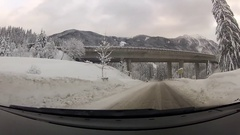 POV of an icy snowy mountain road in the winter. Stock Footage