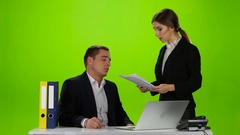 Woman boss chastises her employee man for badly made report Stock Footage