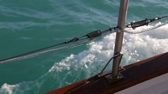Ocean water rushing beneath wooden ship plank Stock Footage
