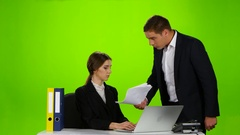Man boss chastises his employee woman for badly made report Stock Footage