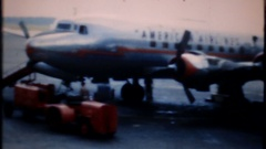 Passenger planes land, load & depart busy airport, 3940 vintage film home movie Stock Footage
