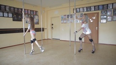 Beautiful young girls Pole dance studio stock footage video Stock Footage