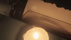 Extreme close-up of paper in a typewriter being set on fire. Stock Footage