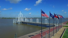 Flags along mississippi river in baton rouge louisiana aerial drone Stock Footage