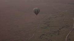 AERIAL: Floating high above the ground over endless Serengeti plains Stock Footage