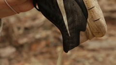 Pouring sand out of a shoe Stock Footage