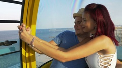Young couple taking selfie in cable car Stock Footage