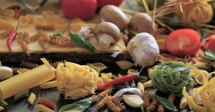 Dolly close up view of different variety of Italian pasta and ingredients Stock Footage