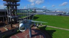 USS Ranger jet downtown Baton Rouge louisiana aerial drone Stock Footage