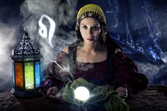 Leo zodiac symbol with fortune teller Stock Photos
