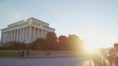 People walking in front of Lincoln Memorial building with lens flare, 4K Stock Footage