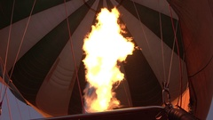 CLOSE UP: Pilot inflates safari balloon with hot air by activating the burners Stock Footage