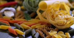 Dolly extreme close up view of different variety of Italian pasta Stock Footage