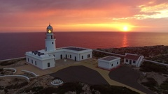 Stunning aerial shot of lighthouse in Menorca Island with beautiful sunrise. Stock Footage