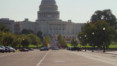 Tilt of DC Capitol Building, parking lot, American Flag, 4K Stock Footage