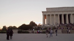 Panning shot of Lincoln Memorial, sunset, crowds, 4K Stock Footage