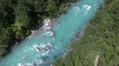 Aerial - High angle view of flying over wide Soča river stream Stock Footage