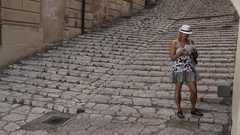 A woman in Portoferraio, Italy on the island of Elba. Stock Footage