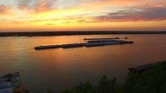 Arc around barges on mississippi river at sunset sunrise aerial drone Stock Footage