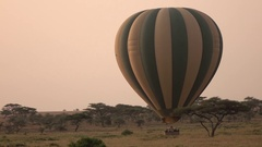 CLOSE UP: Tourists in safari balloon leaving the ground starting adventure Stock Footage