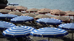 Umbrellas on the beach of Monterosso al Mare in the Cinque Terre region of Ligur Stock Footage