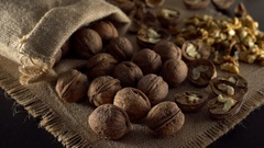 Walnuts in rotation on sackcloth background Stock Footage