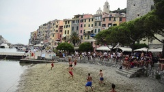 Boys playing soccer / football on the beach of Porto Venere, Liguria, Italy Stock Footage