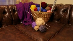 Balls of varicoloured threads in a basket for needlework. Stock Footage