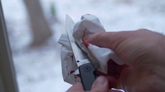 Clean blood off stiletto knife cleaning Stock Footage