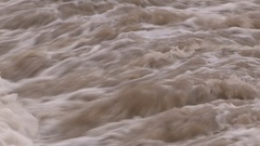Spring river flooding and fast moving water in warm January weather Stock Footage