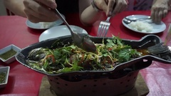 Chinese family eating whole fish steam in soy sauce with chopsticks Stock Footage
