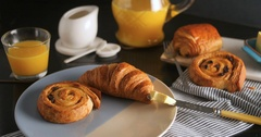 Dolly view of a French breakfast with pastries, orange juice and coffee Stock Footage