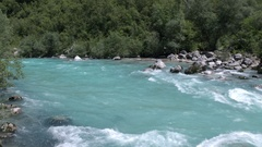 Aerial - Fast waters of emerald river running through the green forest valley Stock Footage