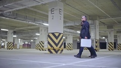 Dangerous Gangsters Walking in Parking Lot Stock Footage