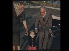 50's grandparents try to teach baby boy to walk Stock Footage