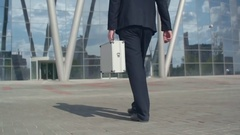 Man with Money Case Walking Outside Stock Footage