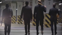 Gangsters Walking with Baseball Bats Stock Footage