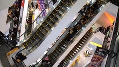People using escalator at Union shopping mall in Bangkok Stock Footage