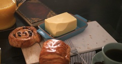 Dolly push out view of a French breakfast with pastries, orange juice and coffee Stock Footage