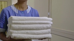 Hotel Housemaid with Clean Towels Stock Footage