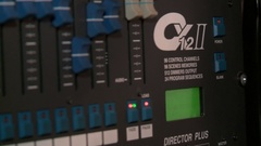 Footage of a recording studios audio console and a hand pulling up the knobs Stock Footage