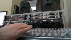 Sound director working on audio mixer in professional studio. Sharp near of hand Stock Footage