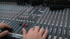 Sound director working on audio mixer in professional studio. Stock Footage