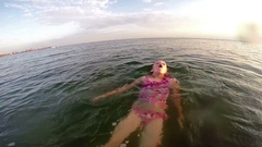 Child swims on back Stock Footage