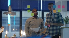 4K Creative business team brainstorming with sticky notes in modern office Stock Footage