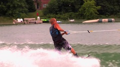 A man doing a jump while wakeboarding on a lake, slow motion. Stock Footage