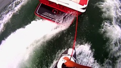 POV of a man skim wakeboarding behind a boat on a lake, slow motion. Stock Footage