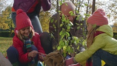 Family Getting Ready for Tree Planting Stock Footage