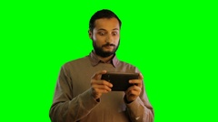 Man emotionally work with tablet on green screen background Stock Footage